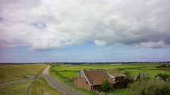 Abandoned farm, dyke and grassland, Texel, Netherlands, 4K time lapse Stock Footage