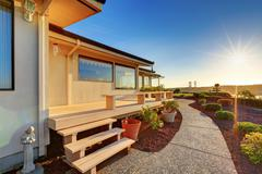 Luxury house exterior at sunset. view of wooden deck with walkway. Northwest, Stock Photos