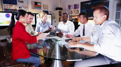 4K Diverse business group discuss profits & loss in a boardroom meeting Stock Footage