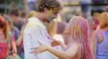 Cheerful couple dancing and hugging at outdoor festival, having fun together 4k or 4k+ Resolution