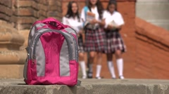 Female Students Walking Towards Backpack Stock Footage