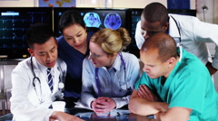 4K Group of colleagues in a medical meeting discuss a patient's x ray results Stock Footage