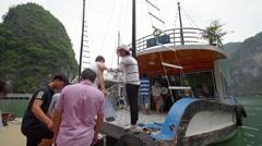 Cruise ship traversing through Ha Long Bay Stock Footage