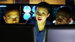 4K Medical team working late at a computer and discussing what they see Stock Footage