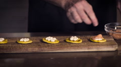 Restaurant hotel private chef preparing making canapes starters snacks Stock Footage