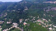 Corfu Paleokastritsa Greece village aerial 4k video. Mountain hills villas Stock Footage