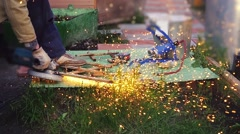 A welder working on the metals outdoor in slow motion. 1920x1080 Stock Footage