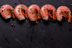 Fresh shrimps served with onion and lime Stock Photos