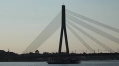 Vesel Drifting In Front Of Cable Stayed Bridge. Stock Footage