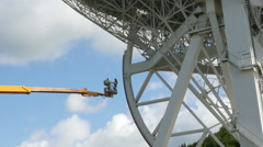 Working renovate huge radio telescope zoom Stock Footage