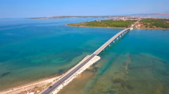 Jaw aerial shot around bridge over sea with bridge road 4K Stock Footage