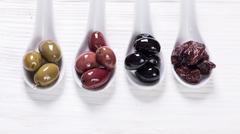 Bowls with kind of olives green olives, black olives, pink olives Stock Photos