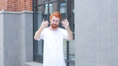 Inviting Young Man, Moving Camera toward Man w/ Beard and Red Hairs Stock Footage