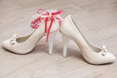 Stylish white female wedding footwear. Bridal shoes Stock Photos