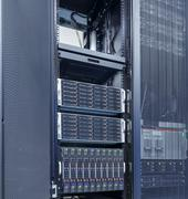 Rows of server hardware with disk storage in data center Kuvituskuvat