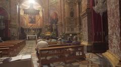 Old church gold people praying Stock Footage