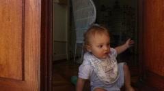 Baby closes doors. Shot of baby closing door Stock Footage