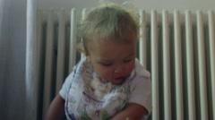 Cute baby boy crawling towards camera. Lens flare hits camera giving a glow effe Stock Footage