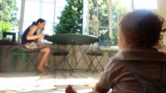 Artistic perspective candid shot of baby boy looking at mother  Stock Footage