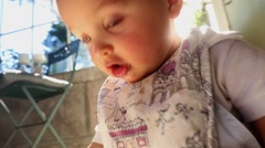 Closeup of baby portrait at home. Lens flare hits camera beautifully Stock Footage