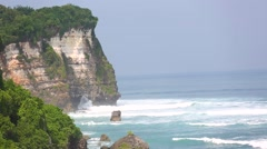 The waves beat against the rock, Beach Uluwatu, Bali, Indonesia. Stock Footage