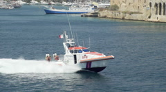 Coastguard boat fast harbour pan Stock Footage
