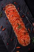 Chorizo salami sausage on rustic background . Stock Photos