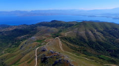 Mount Pantokrator Corfu Greece aerial HD video. Sea strait top mountain coast Stock Footage