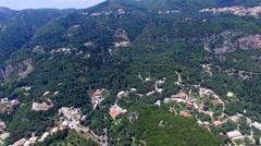 Corfu Paleokastritsa Greece village aerial HD video. Mountain hills villas Stock Footage