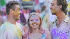 Two male friends kissing beautiful girl on cheeks by surprise, happy people Stock Footage