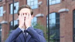 Upset Young Businessman with Headache and Frustration of Failure Stock Footage