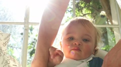 Mother lifting baby to her arms Stock Footage