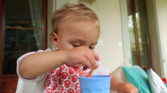 Baby playing with food. Stock Footage