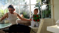 Mother feeding baby. Mom giving food to toddler. Feeding baby Stock Footage