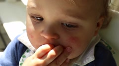 Close up of baby. Portrait of contemplative baby boy thinking. Stock Footage