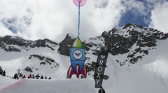 View cardboard rocket tie to colorful air balloons. Ski resort. Mountains. Event Stock Footage