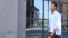 Happy Young Black Man Walking, Outdoor Stock Footage