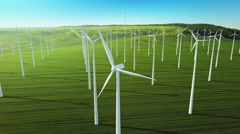 Aerial fly over grow up building wind turbines generating energy Stock Footage