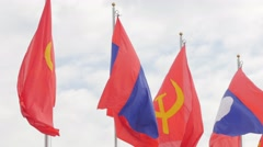 Lao national and communist flag along Mekong river,Vientiane,Laos Stock Footage