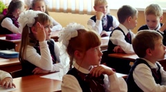 Novosibirsk, Russia - september, 1, 2015. First-grade students and teacher are Stock Footage