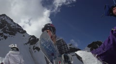 Girl with snowboard walk on ski resort. Ski resort. Helmet. Sunny cloudness day Stock Footage