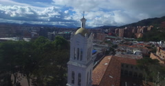 Aerial circling around the Usaquen church bell tower Stock Footage