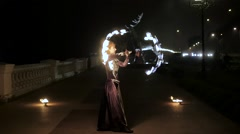 Fire show with fans on the street Stock Footage