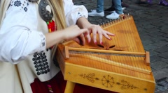 Playing  on the Latvian  folk instrument kokle in Riga. Stock Footage