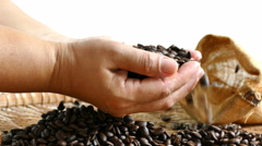 4K  footage of Aromatic roasted coffee beans in hand Stock Footage