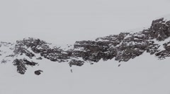 Panoramic view of snowy mountains peaks. Grey weather. Nature. Landscape Stock Footage