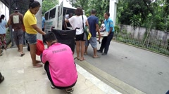 Patient is carried out from ambulance Stock Footage