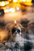 Halloween: Spooky Lit Skull Candle With Mysterious Fog Stock Photos