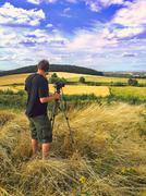 Man taking panoramic landscapes in Sudety Range, Poland Stock Photos