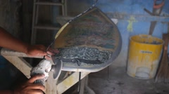 Сraftsman Polishing Surfboard at Workshop on Bali Stock Footage